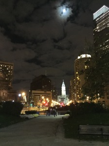 looking down the Benjamin Franklin Parkway at City Hall and a bright moon